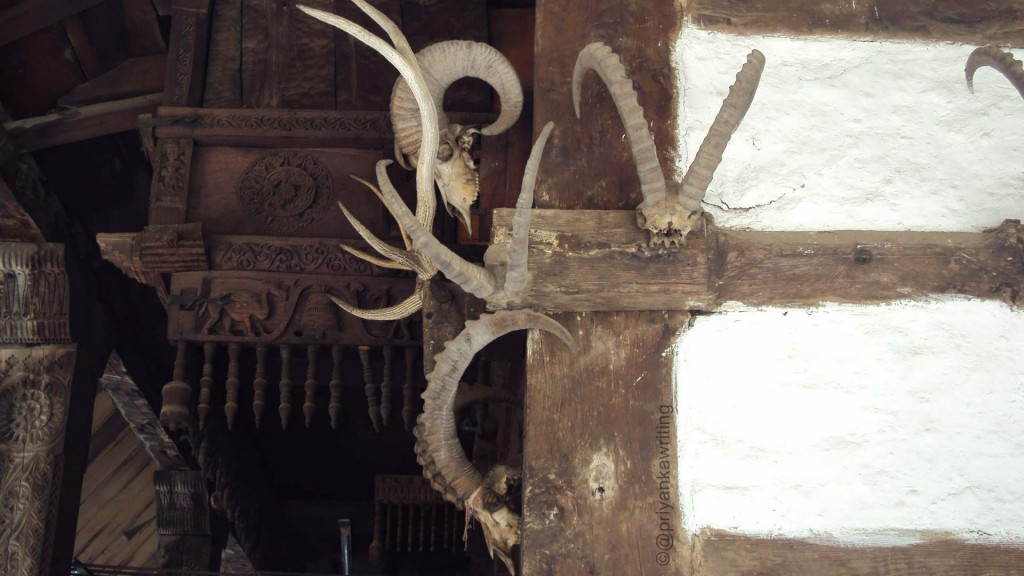 Horns & animal bone skeletons outside on the temple walls